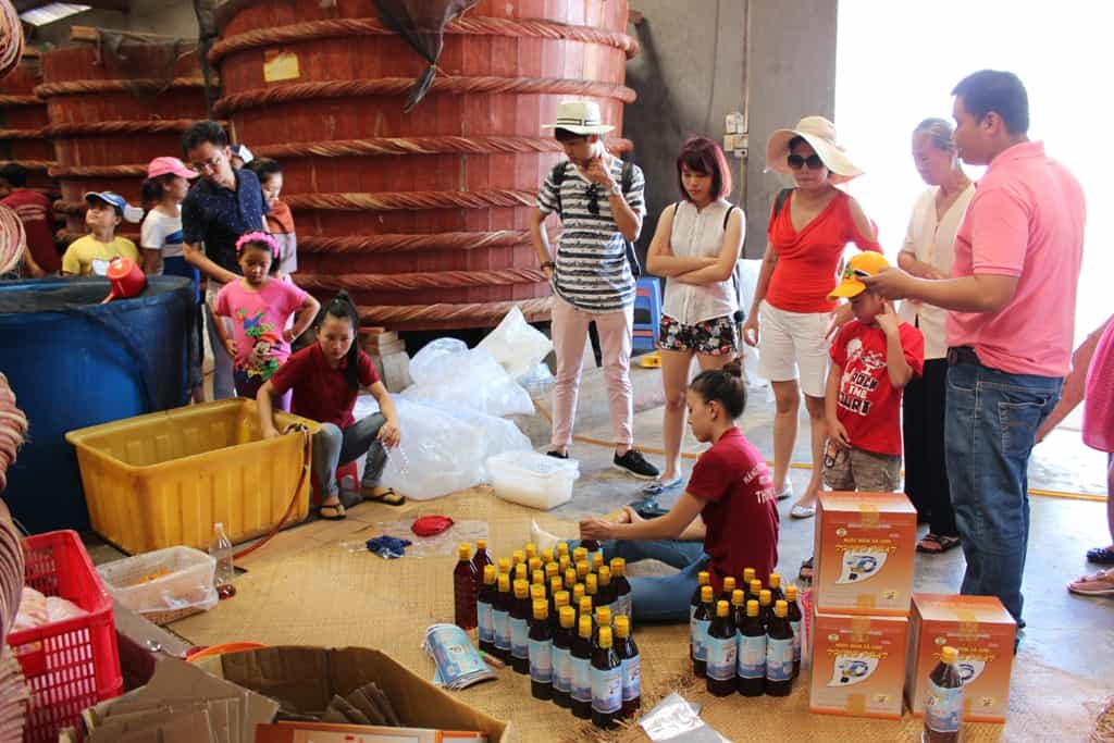 Nuoc-Mam-is-bottled-right-in-the-Fish-Sauce-factory-for-tourists